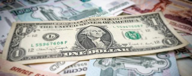Банк России повысил курс доллара до 59 рублей