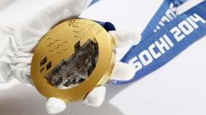 A gold medal manufactured for the 2014 Winter Olympic Games in Sochi, is seen on display at the Adamas jewellery factory in Moscow